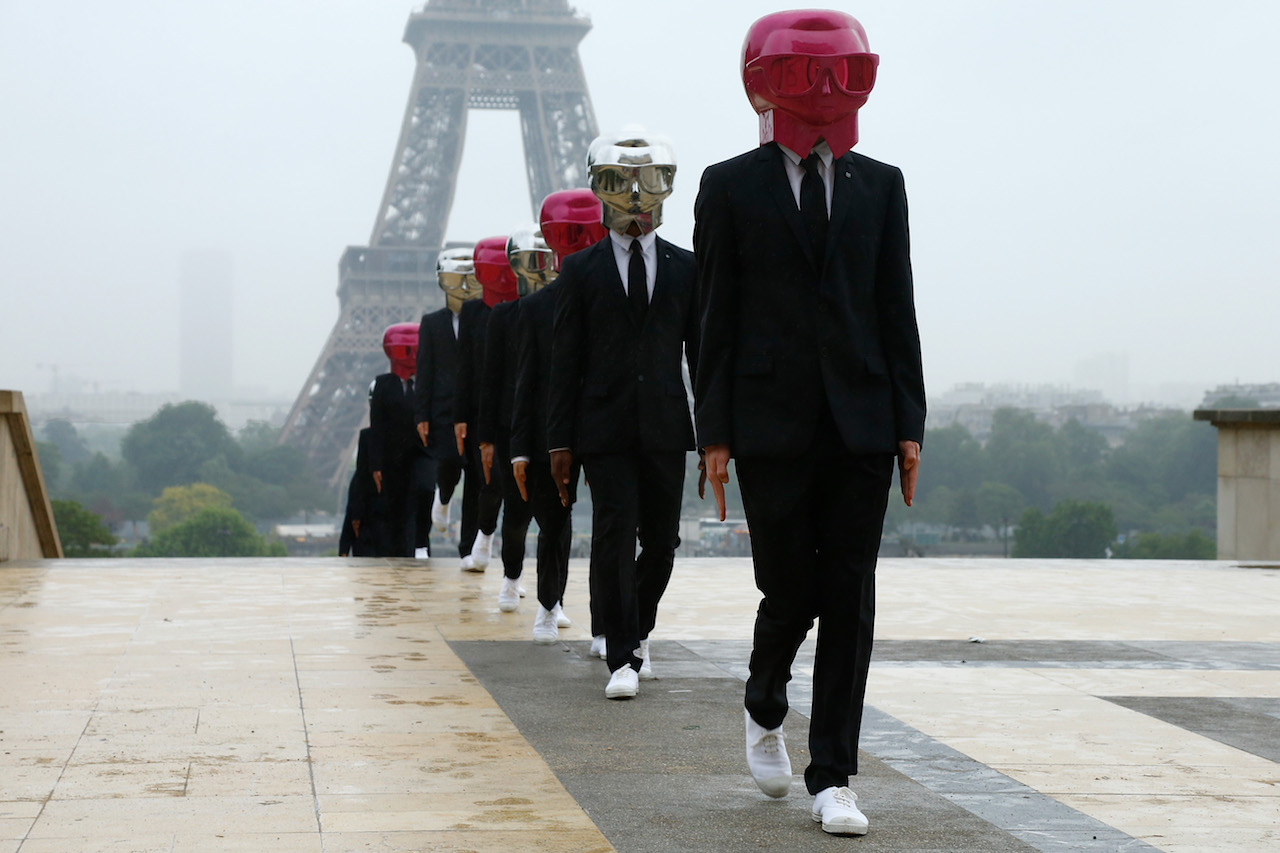 PARIS, FRANCE - MAY 14: Beauty Butlers Flashmob performs in front The Eiffel Tower at Trocadero as part of KARL LAGERFELD & ModelCo. product launch on May 14, 2018 in Paris, France. (Photo by Julien M. Hekimian/Getty Images for ModelCo)