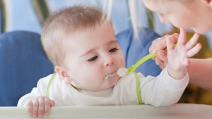 woman-feeding-baby-93497986-small