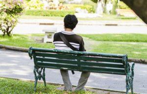 123RF man sitting alone on park