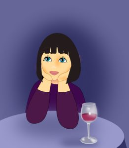 50758169 - a girl sitting at a table with a wine glass.