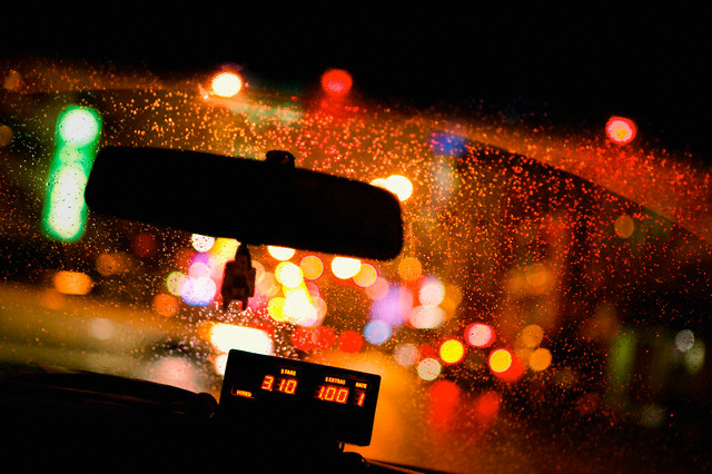 Interior of taxi at night --- Image by © Bruno Ehrs/Corbis