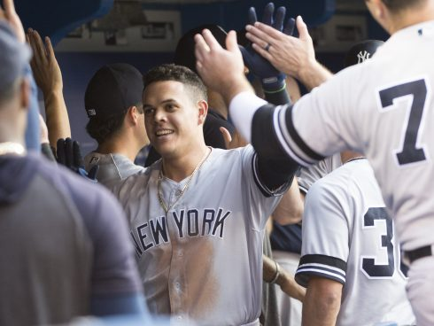 Aug 8, 2019; Toronto, Ontario, CAN; New York Yankees third baseman Gio Urshela (29) celebrates in the dugout after hitting a two run home run during the third inning against the Toronto Blue at Rogers Centre. Mandatory Credit: Nick Turchiaro-USA TODAY Sports