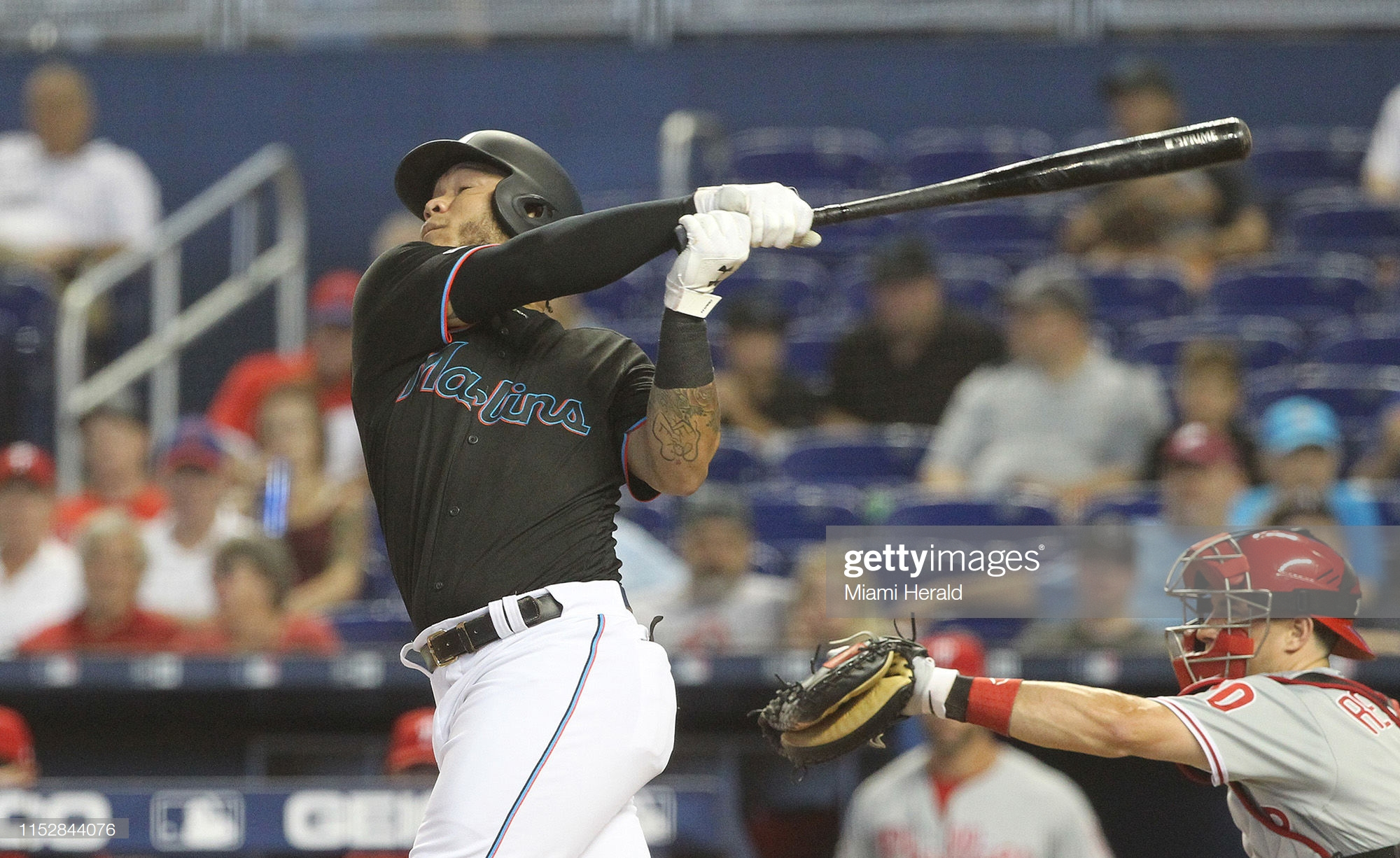 The Miami Marlins' Miguel Harold Ramirez hits a single in the first inning against the Philadelphia Phillies at Marlins Park in Miami on Saturday, June 29, 2019. (Pedro Portal/Miami Herald/TNS via Getty Images)