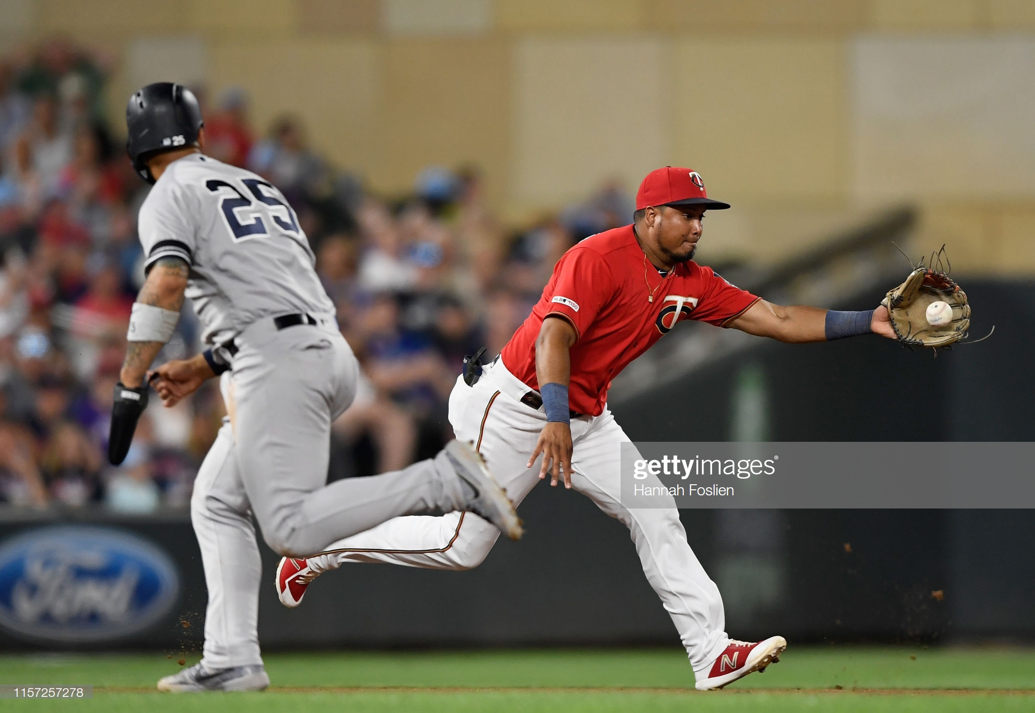 MINNEAPOLIS, MN - JULY 22: Gleyber Torres #25 of the New York Yankees runs to third base as Luis Arraez #2 of the Minnesota Twins fields the ball hit by Gio Urshela #29 of the New York Yankees during the sixth inning of the game on July 22, 2019 at Target Field in Minneapolis, Minnesota. (Photo by Hannah Foslien/Getty Images)
