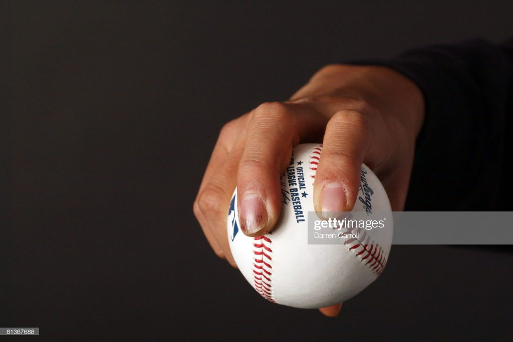 UNITED STATES - APRIL 09: Baseball: Closeup of hand of New York Yankees pitcher Chien-Ming Wang (40) demonstrating sinker grip on ball, equipment at Kauffman Stadium, Kansas City, MO 4/9/2008 (Photo by Darren Carroll/Sports Illustrated via Getty Images) (SetNumber: X80093 TK1 R1 F1)