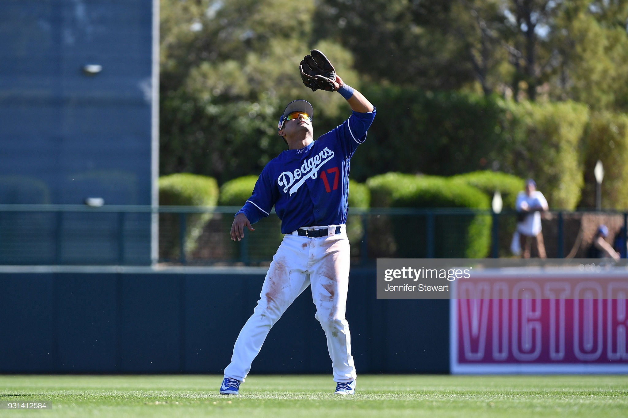 GLENDALE, AZ - MARCH 03: Donovan Solano #17 of the Los Angeles Dodgers catches a fly ball in a spring-training game against the Arizona Diamondbacks at Camelback Ranch on March 3, 2018 in Glendale, Arizona. (Photo by Jennifer Stewart/Getty Images)