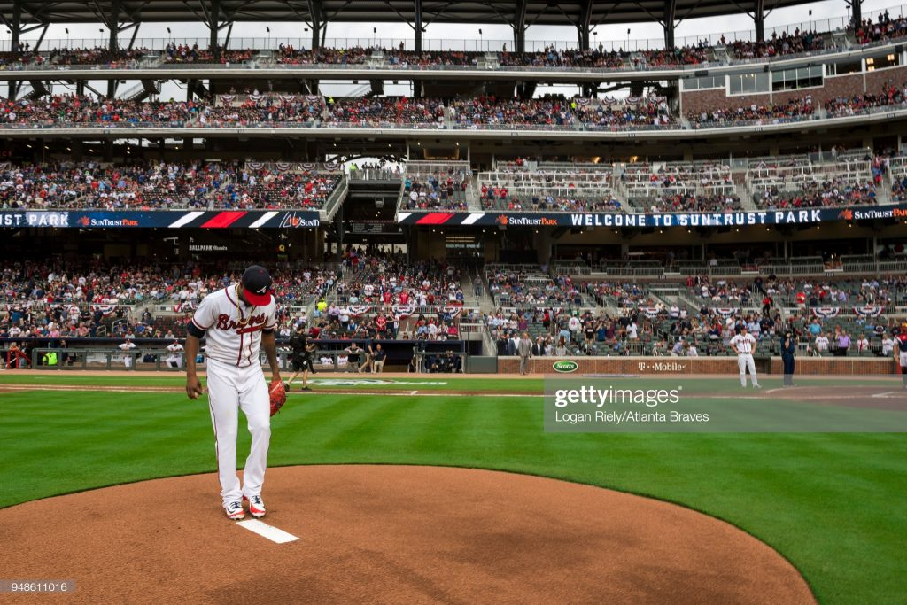 ATLANTA, GA - MARCH 29: Julio Teheran #49 of the Atlanta Braves throws out the first pitch against the Philadelphia Phillies on Opening Day at SunTrust Park on March 29, 2018, in Atlanta, Georgia. (Photo by Logan Riely/Beam Imagination/Atlanta Braves/Getty Images) *** Local Caption *** Julio Teheran