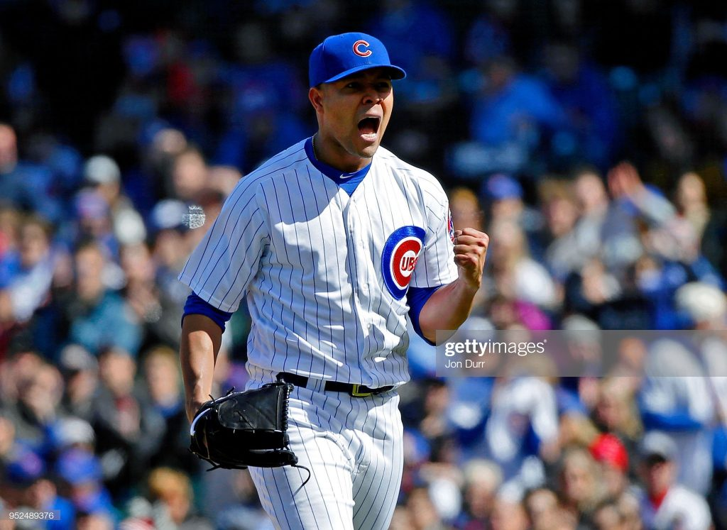 CHICAGO, IL - APRIL 28: Jose Quintana #62 of the Chicago Cubs reacts after striking out Jonathan Villar #5 of the Milwaukee Brewers (not pictured) to end the seventh inning at Wrigley Field on April 28, 2018 in Chicago, Illinois. (Photo by Jon Durr/Getty Images)