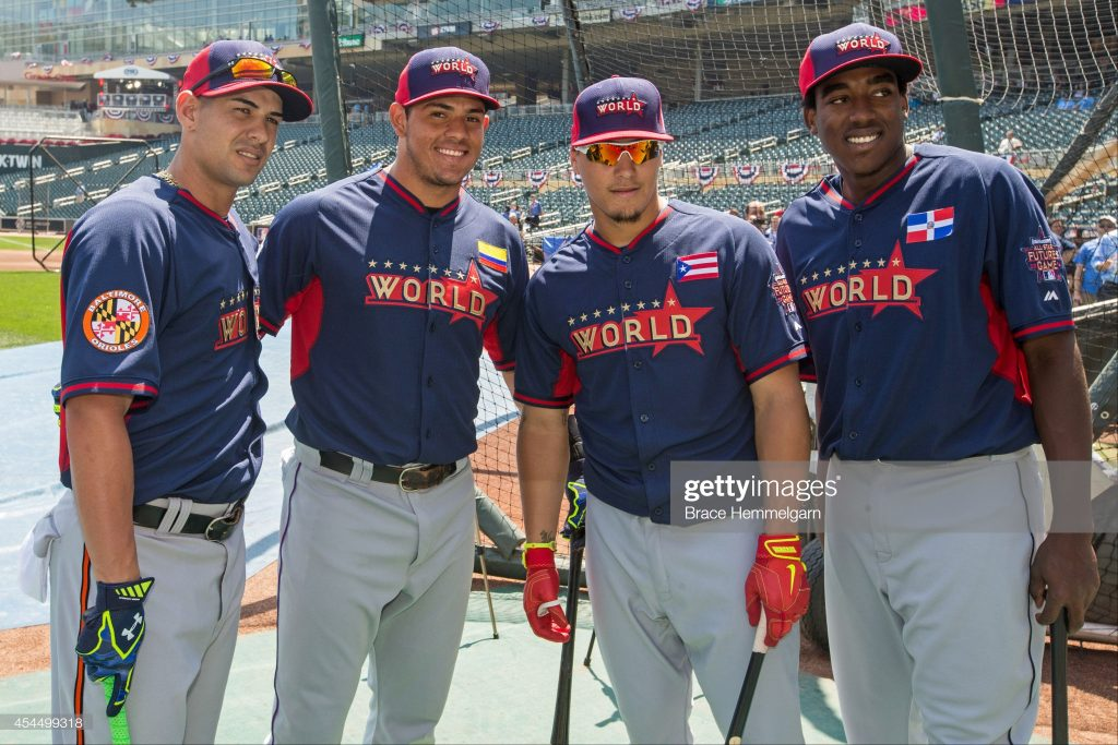 MINNEAPOLIS, MN- JULY 13: Dariel Alvarez #10, Jorge Alfaro #24, Javier Baez #22 and Gabby Guerrero #22 of the World Team during the SiriusXM All-Star Futures Game at Target Field on July 13, 2014 in Minneapolis, Minnesota. (Photo by Brace Hemmelgarn/Minnesota Twins/Getty Images)