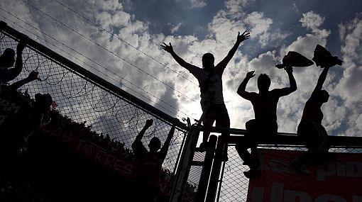 Independiente's fans celebrate the fourth goal of their team during an Argentine league soccer match against Racing Club in Buenos Aires, Argentina, Saturday, April 14, 2012.  Independiente won 4-1. (AP Photo/Natacha Pisarenko)