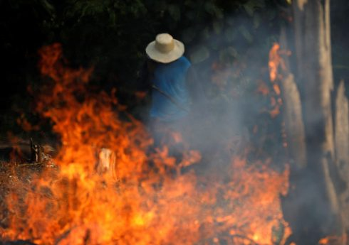 A man works in a burning tract of Amazon jungle as it is being cleared by loggers and farmers in Iranduba, Amazonas state, Brazil August 20, 2019. REUTERS/Bruno Kelly